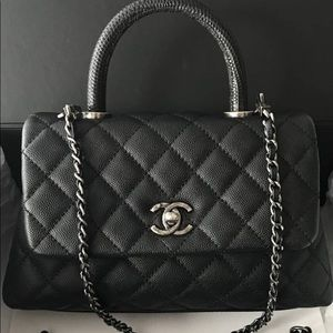 5c35a86c015534 CHANEL. Chanel small Coco handle bag with lizard handle
